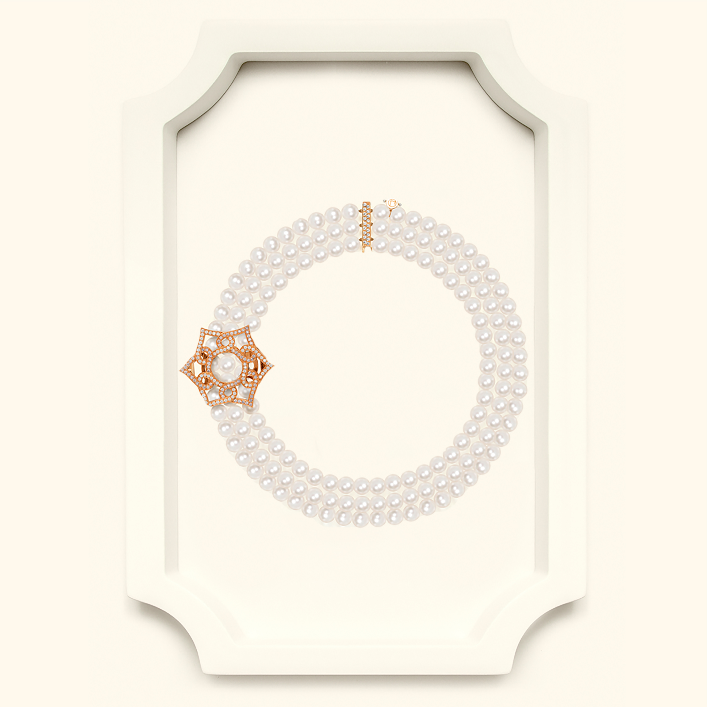 Three row pearl necklace with Islamic inspired clasp